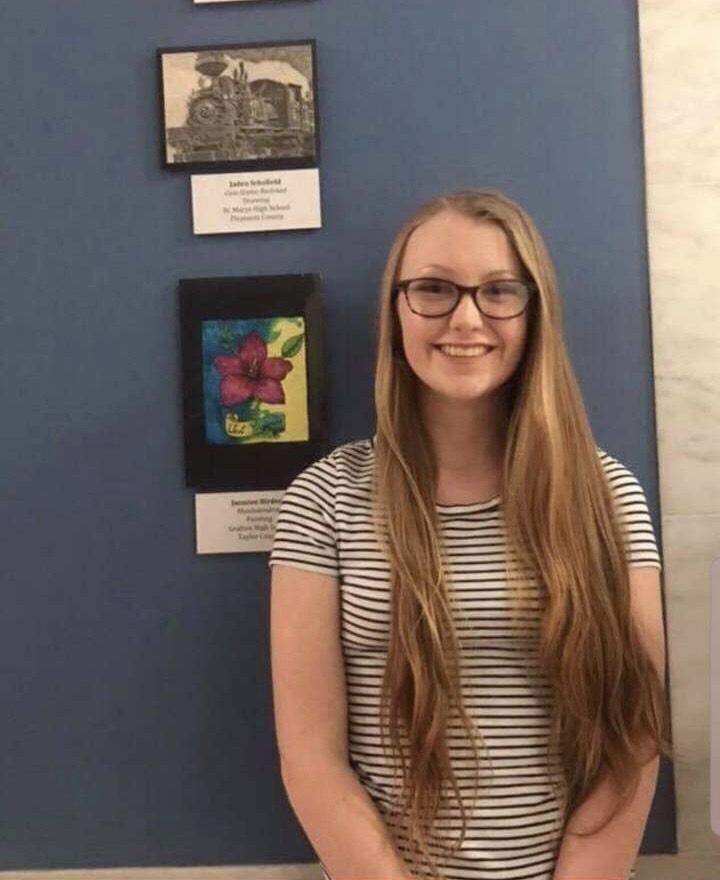 Jaden+proudly+standing+beside+her+artwork