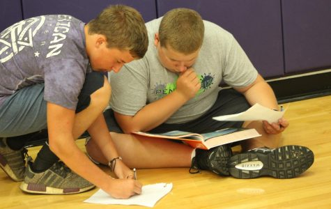 Two students work on their scavenger hunt.
