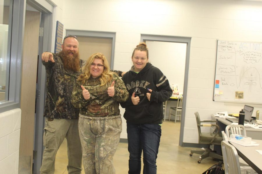 Mr.Childers, Aimee Chambers, and Shianne Mcbrayer pose for a photo on Camp Day.
