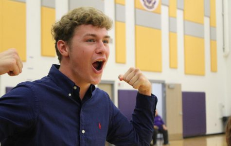 Peyton Oliver cheers on the senior class at the pep rally.