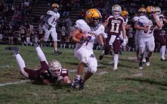 Senior Ben Long runs the ball toward the end zone.